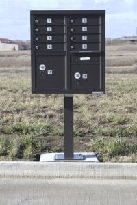 "A ""cluster unit mailbox"" sits too close to Travertine Road in the Blackstone Trails subdivision in east Normal. It is one of several the town will likely ask developers to move because it is on public right-of-way."