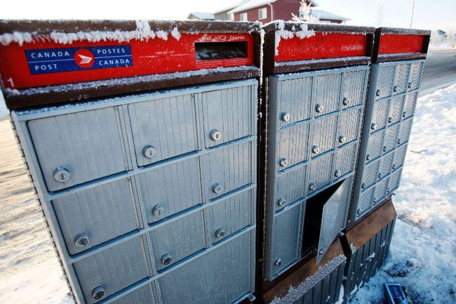 The parcel compartment of a community mailbox sits ajar on 75A Street in the Westpointe neighbourhood in Grande Prairie in December, 2014.