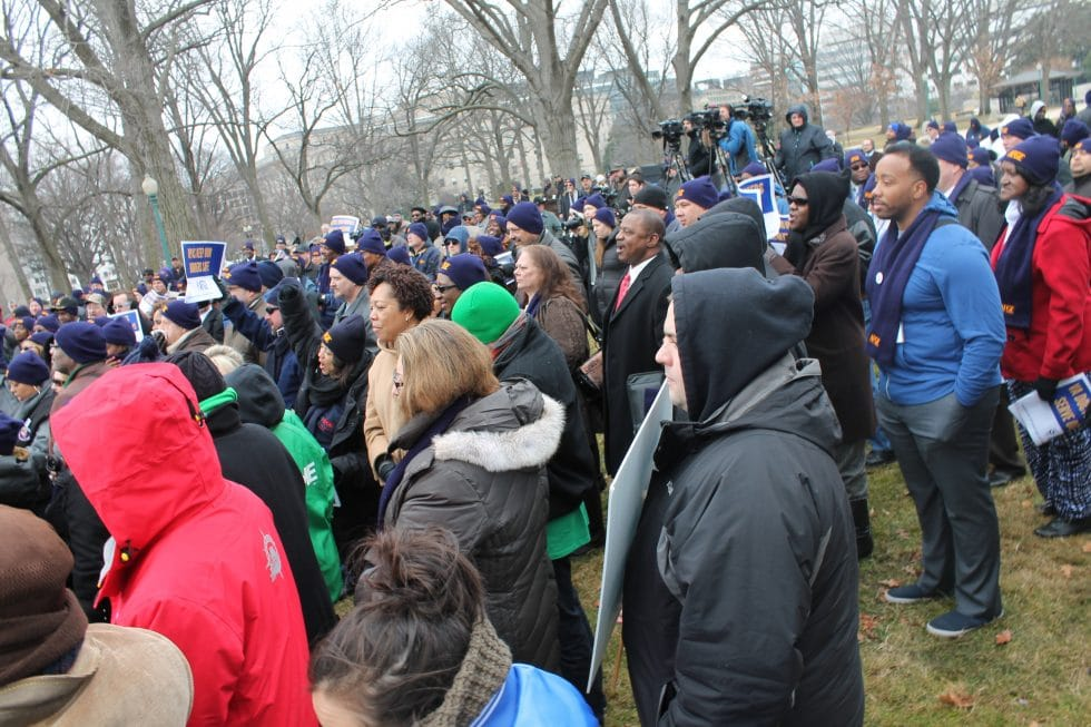 Union members, lawmakers and activists braved the cold in Upper Senate Park.