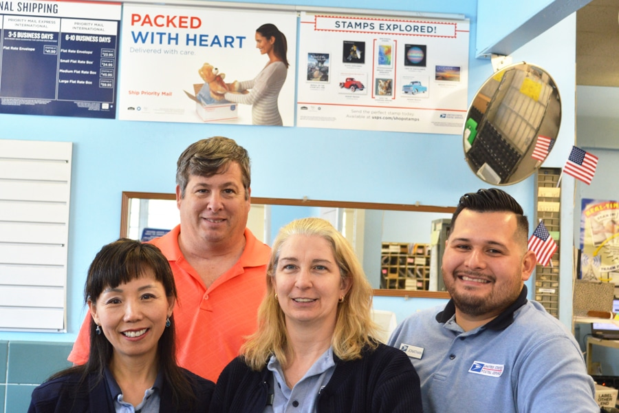The Tobyhanna, PA, Post Office regularly ranks highly in retail performance. Postmaster Robert Grasso stands behind, from left, retail associates Sonha Mayatte, Patricia Lombardi and Jonathan Figueroa.