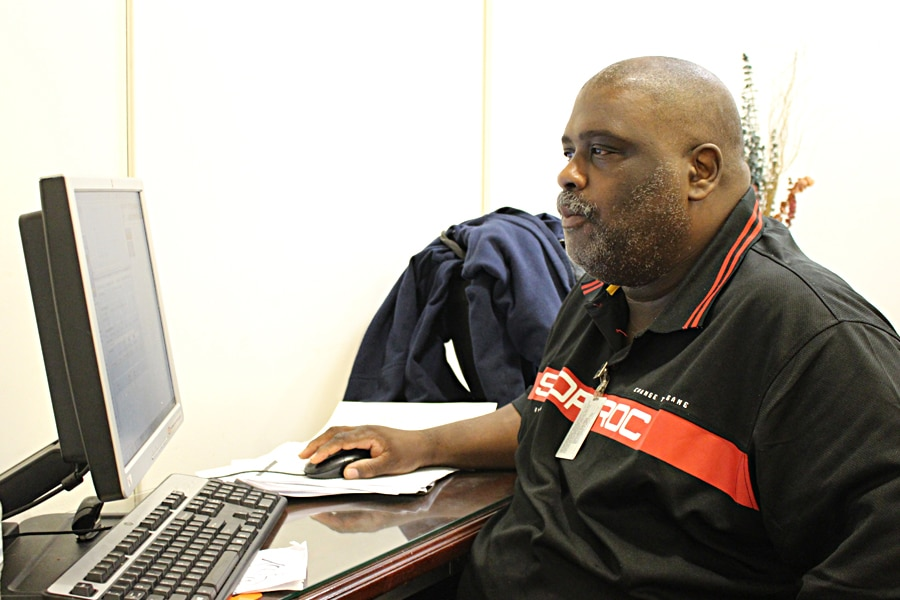 Chicago Letter Carrier James Robinson reviews records in a database, part of a project to boost efficiency.