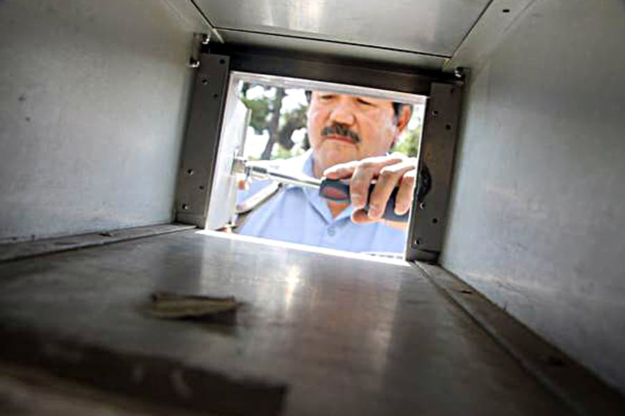 David Garcia changes a lock in Nevada-Sierra District, where he is one of eight maintenance mechanics who change more than 3,000 locks a month.