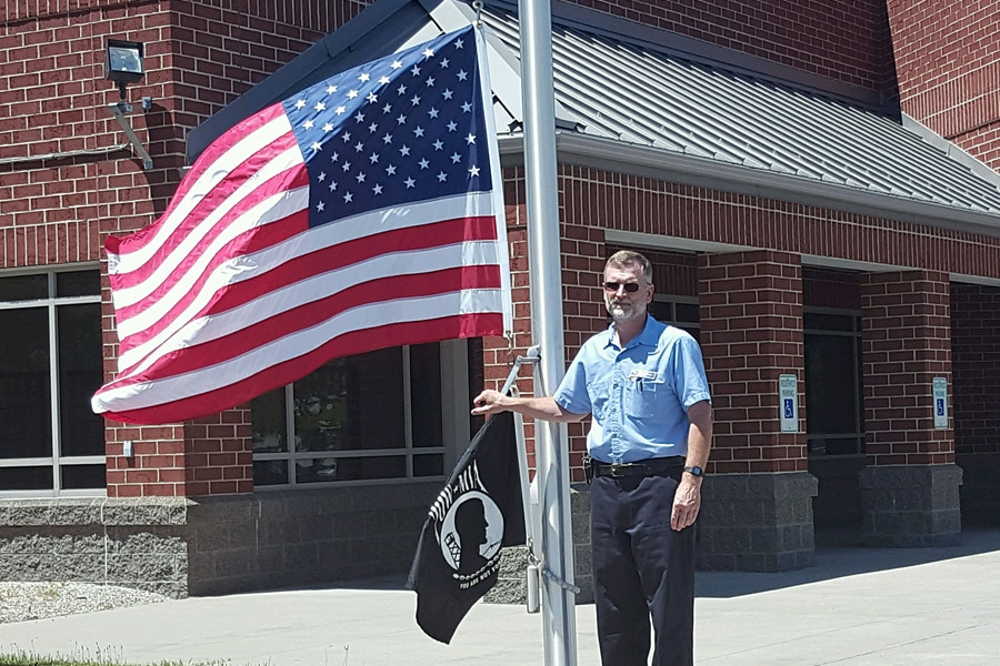 Fremont, OH, Custodian Mark Venis prepares to raise the U.S. and POW-MIA flags.
