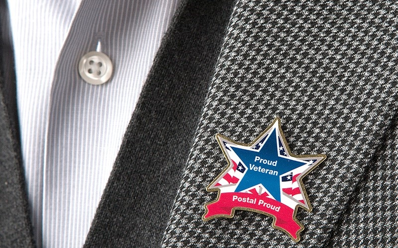 USPS is distributing lapel pins to employees who served in the armed forces.